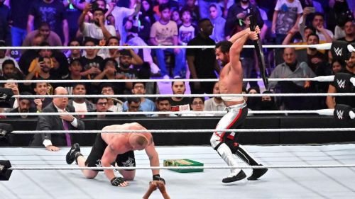 Lesnar tried to cash-in but was neutralised by a Steel-chair wielding Seth Rollins