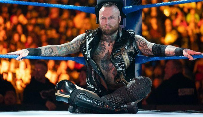 Which Superstar will step up to eventually confront Aleister Black?