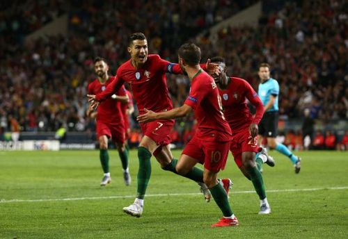 Portugal players wheel away to celebrate with talisman Ronaldo after his hat-trick in their semi-final win