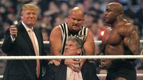 Donald Trump prepares to shave Vince McMahon's head, egged on by Stone Cold Steve Austin and Trump's 'champion' Lashley.