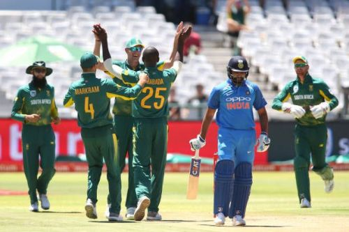 Rohit Sharma surrounded by the South Africans