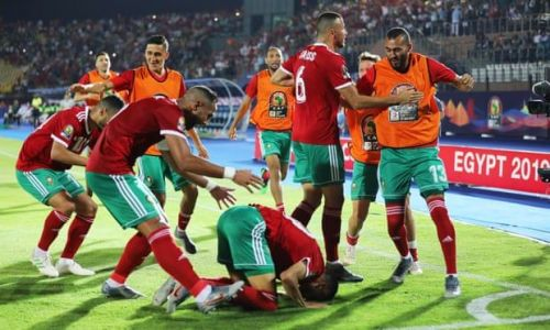 Morocco celebrates an automatic qualification into the knockout stages.