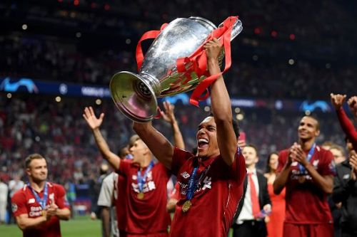 Trent Alexander-Arnold celebrates with the UEFA Champions League trophy after Liverpool's win on June 1