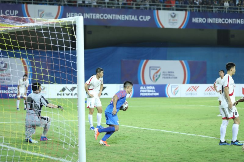 Sunil Chhetri takes the ball in his hand to restart the game quickly after scoring India