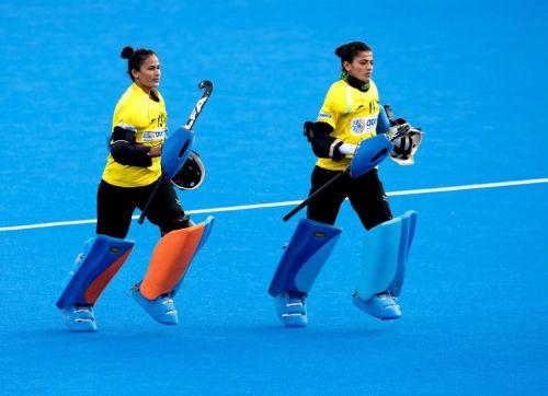 Rajani Etimarpu and Savita warm-up before a match