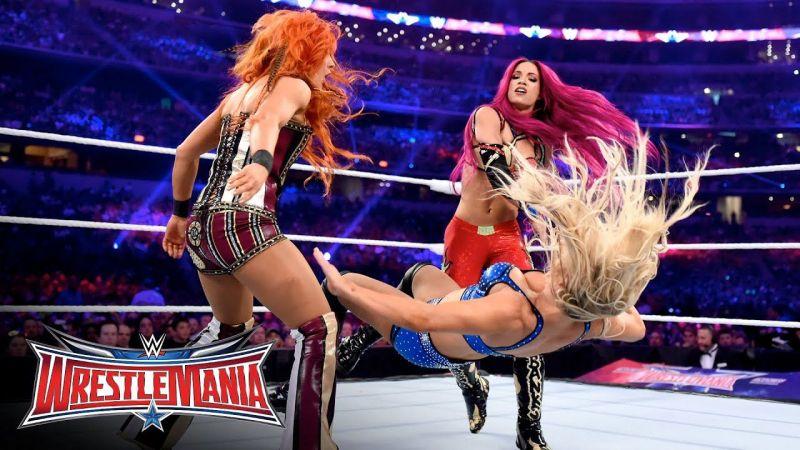 Lynch, Sasha, and Charlotte at WrestleMania 32