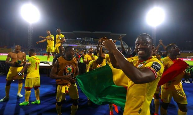Benin celebrate a draw that sees them through to the round of 16.