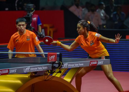 Chuang and Ayhika in action during the mixed doubles match
