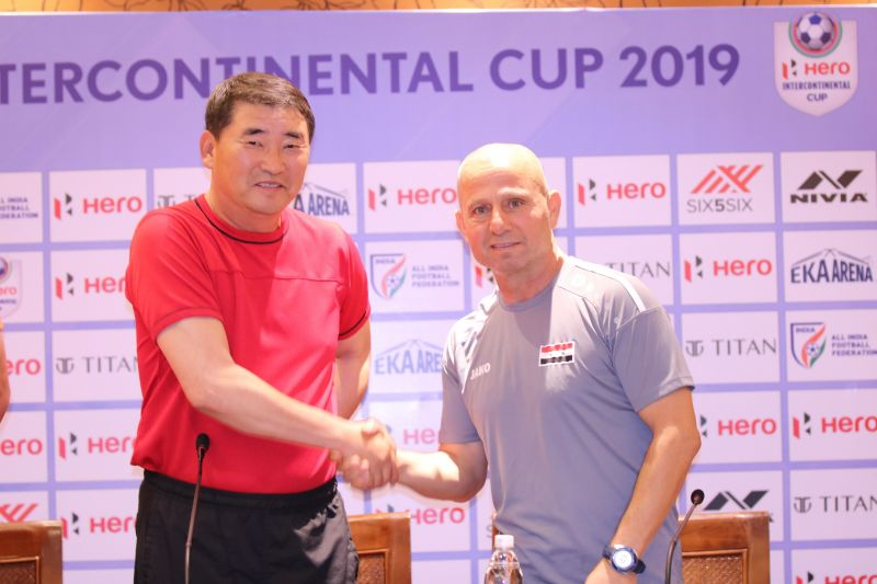 DPR Korea head coach Yun Jung Su shakes hands with his Syrian counterpart before the commencement of the Intercontinental Cup