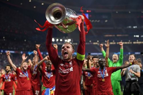Jordan Henderson lifting Champions League trophy