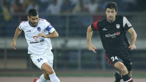 Marti Crespi (left) tussles for the ball with Juan Mascia (right) in the ISL