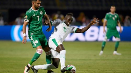 Senegal's Sadio Mane tussles with Algeria's Riyad Mahrez during their group C clash