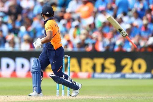 Rishabh Pant's bat flying after a reckless shot