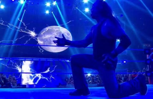 The Undertaker celebrates his tag team victory at WWE Extreme Rules