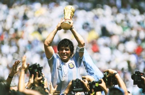 Maradona with the 1986 FIFA World Cup title