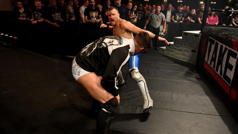Jordan Devlin attacks and injures Travis Banks before their scheduled TakeOver match