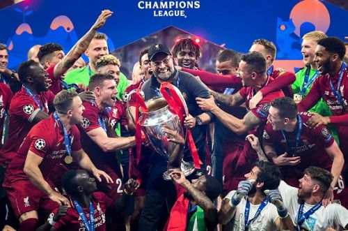 The Liverpool team with the Champions League trophy