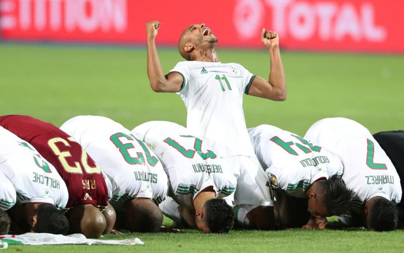 The Desert Foxes of Algeria celebrate their victory