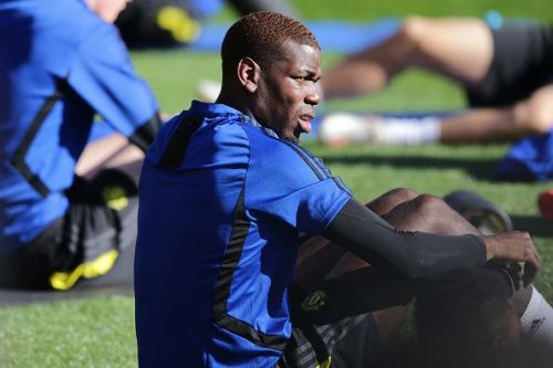 Paul Pogba has reported for Manchester United's pre-season training amid an uncertain future.