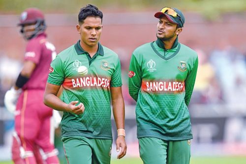 Mohammad Saifuddin (L) is the third highest-wicket taker for Bangladesh