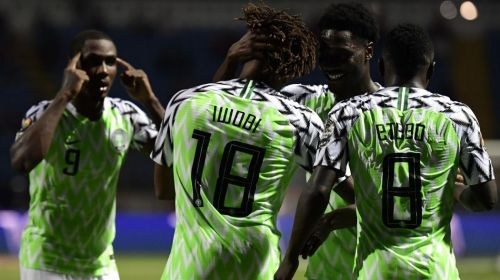 Iwobi celebrates with teamwhile star man Ighalo (far left) stresses they keep their heads