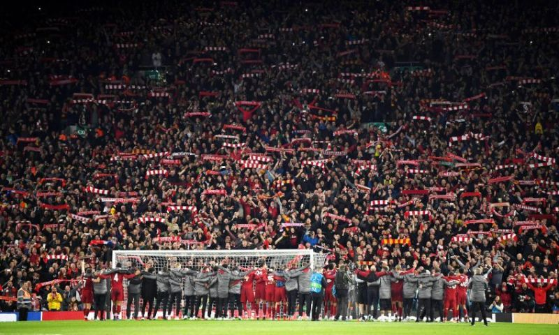 Liverpool players and staff celebrating their comeback against FC Barcelona