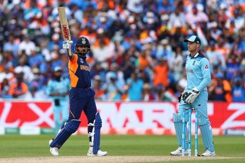 Virat Kohli lifts his bat as England wicketkeeper Jos Buttler looks on