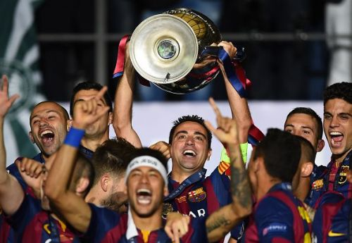 Xavi raises one of many trophies with the Blaugrana.
