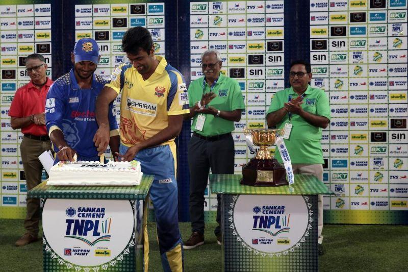 KB Arun Karthick and Ravichandran Ashwin cut a cake as part of the 100th match celebrations of the TNPL 2019