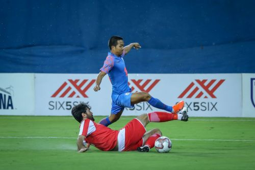 Tajikistan's Siyovush Asrorov lunges on Lallianzuala Chhangte which eventually awards India a penalty