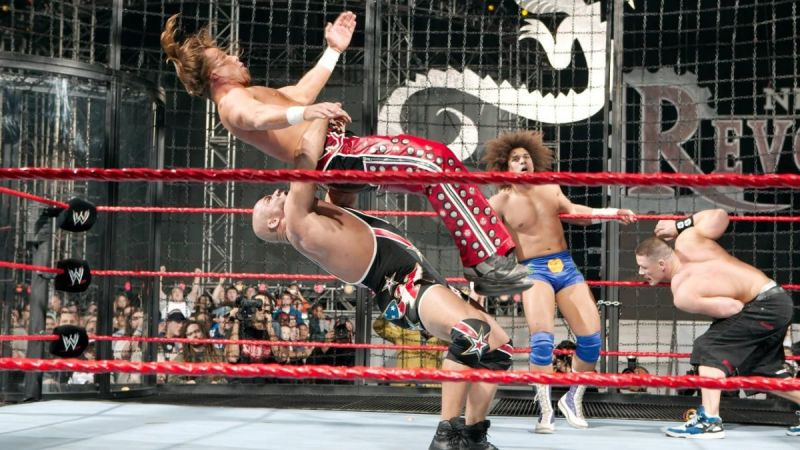 A weary John Cena and Carlito look on as Kurt Angle takes Shawn Michaels to Suplex City