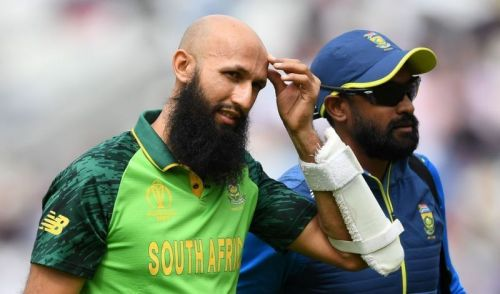 Amla walks back after being hit on the helmet