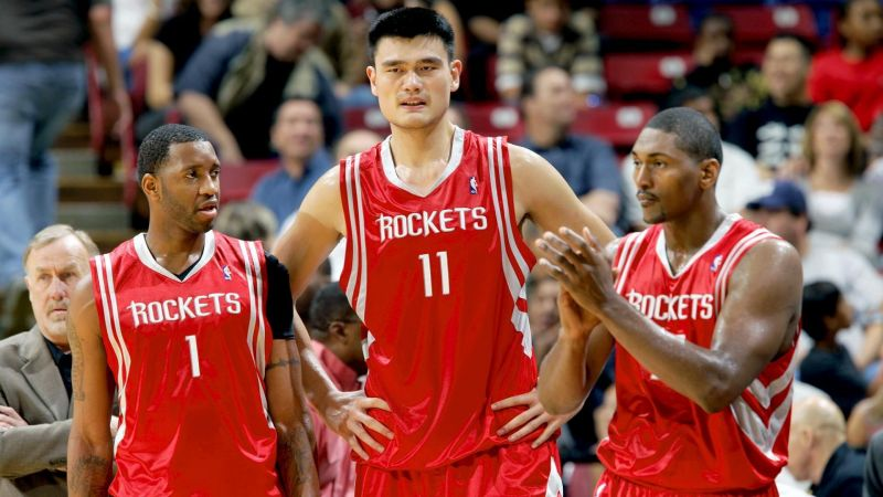 Tracy McGrady, Yao Ming, and Ron Artest leading the Houston Rockets