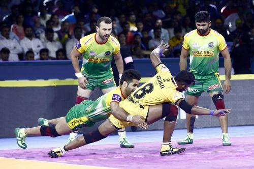 Telugu Titans raider Suraj Desai deals with the Patna Pirates