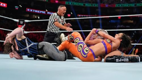 Bayley looking strong as she takes down two wrestlers with submission moves on Sunday