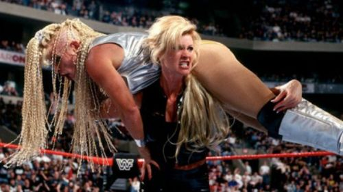 Sable delivers the match-winning TKO to Luna Vachon at Wrestlemania XIV