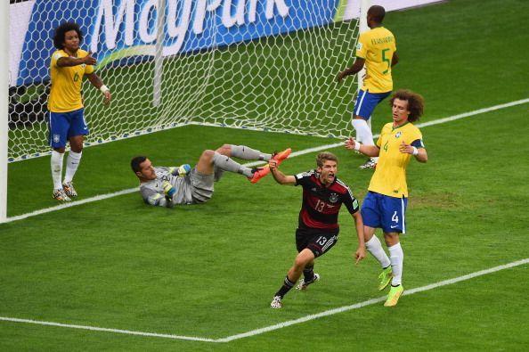 Muller celebrates the opener vs Brazil at Belo Horizonte in WC 2014 SF1.