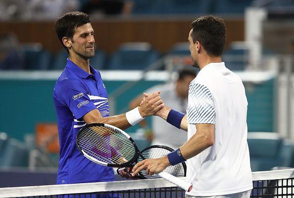 Novak Djokovic(L) and Roberto Bautista Agut