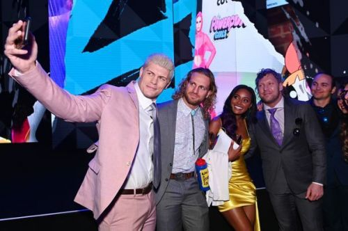 Cody, Brandi, Adam Page, and Kenny Omega pose for a photo after the TNT announcement.