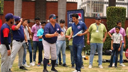 Delhi Capitals' assistant coach Mohammad Kaif prepares to face a pitch from Jim Small, Senior Vice President International, MLB
