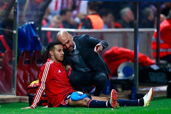 Pep Guardiola with Thiago on the touchline in a UCL game.