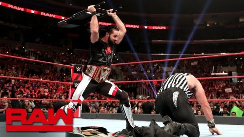 Seth Rollins smashes Elias with a steel chair, not stopping because of a referee shirt.