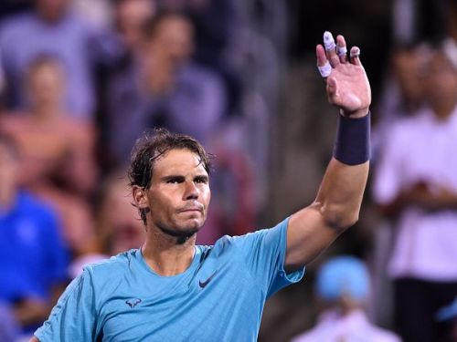 Nadal waves to the crowd after his quarterfinal win over Fognini