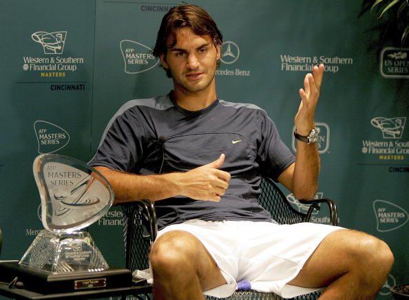 Federer poses with his 1st Cincinnati trophy in 2005