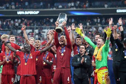 Virgil van Dijk holding the UEFA Super Cup for Liverpool