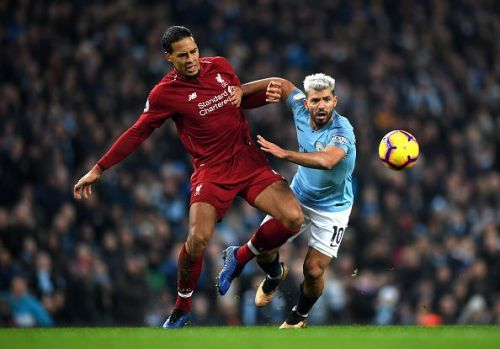 Sergio Aguero (right) and Virjil Van Dijk tussle for the ball.