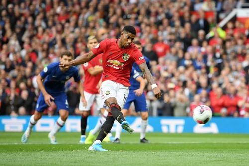 Marcus Rashford scores from the spot against Chelsea at Old Trafford