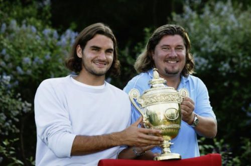 Federer celebrates his first Grand Slam singles title at 2003 Wimbledon with coach Lundgren