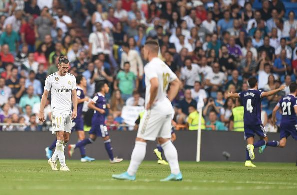 Real Madrid players look deflated after conceding a late equaliser to Valladolid