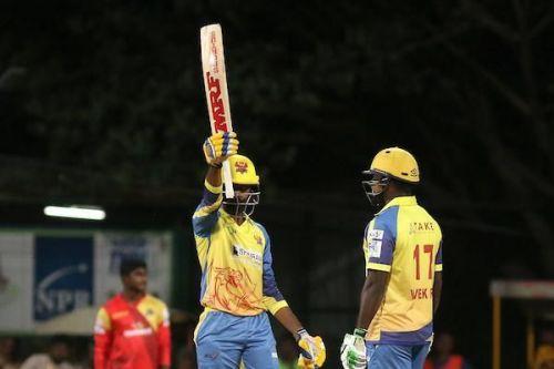 Hari Nishaanth of Dindigul Dragons lifts his bat high after scoring a half-century against VB Kanchi Veerans in the Sankar Cement TNPL 2019 at the NPR Cricket Ground, Natham, Dindigul